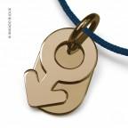Pendentif Sex Symbol en or jaune mikado